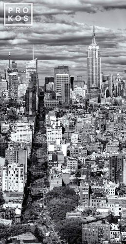 A vertical cityscape photo of Manhattan as seen from from SoHo in black and white.
