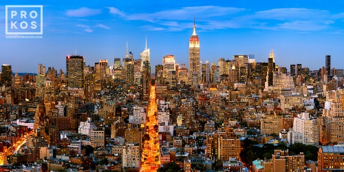 A panoramic cityscape of Manhattan with the Empire State Building and Chrysler building at dusk, New York City.