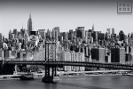 A fine art cityscape photo of the New York City skyline and the Manhattan Bridge in black and white