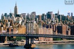 A daytime cityscape photo of Midtown Manhattan and the Manhattan Bridge