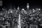 A panoramic cityscape of the buildings of Midtown Manhattan and the Empire State Building at night in black and white. Large-scale fine art prints of this ultra high-definition photo are available up to 120 inches wide.