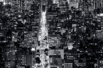 An ultra high-definition vertical cityscape of Manhattan at night in black and white. Large-scale fine art prints of this photo are available up to 120 inches in height.