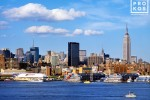 Skyline of New York City, the Hudson River, and Empire State Building during the day as seen from Hoboken, New Jersey