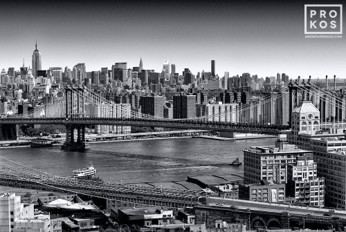 An aerial photo of Midtown Manhattan and the Manhattan Bridge in black and white, New York City