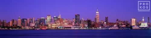 A large-scale panoramic skyline of New York City and the Hudson River at dusk as seen from Hoboken, NJ