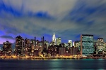 A panorama of Midtown Manhattan at dusk as seen from Queens, New York City
