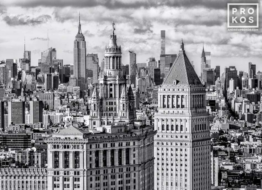 "A black and white photograph of the Municipal Building, 40 Centre Street, and the skyscrapers of Midtown Manhattan and the Empire State Building in the distance, New York City. Framed fine art prints of this photo are available up to 72"" wide."