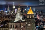 A fine art photograph of the Municipal Building, 40 Centre Street, and the skyscrapers of Midtown Manhattan and the Empire State Building at night in the distance, New York City