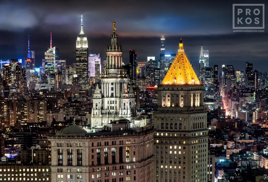 """A fine art photograph of the Municipal Building, 40 Centre Street, and the skyscrapers of Midtown Manhattan and the Empire State Building at night in the distance, New York City. Framed prints of this photo are available up to 72"""" wide."""