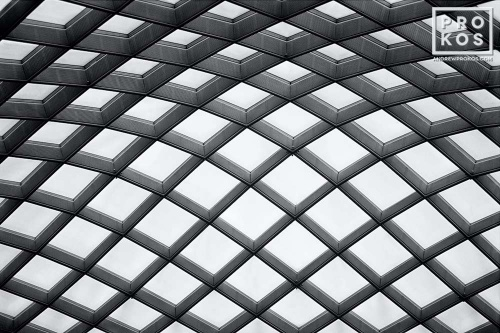 An architectural photo of the undulating glass and steel canopy of Kogod Courtyard, National Portrait Gallery, Washington DC