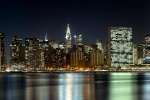 An ultra-wide skyline photograph of Midtown Manhattan at night, New York City