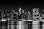 An ultra-wide skyline photograph of Midtown Manhattan at night in black and white, New York City