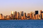 A panorama of the skyline of New York City and New York Harbor at sunset