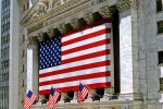 A color architectural exterior photo of the New York Stock Exchange (NYSE) and American flags