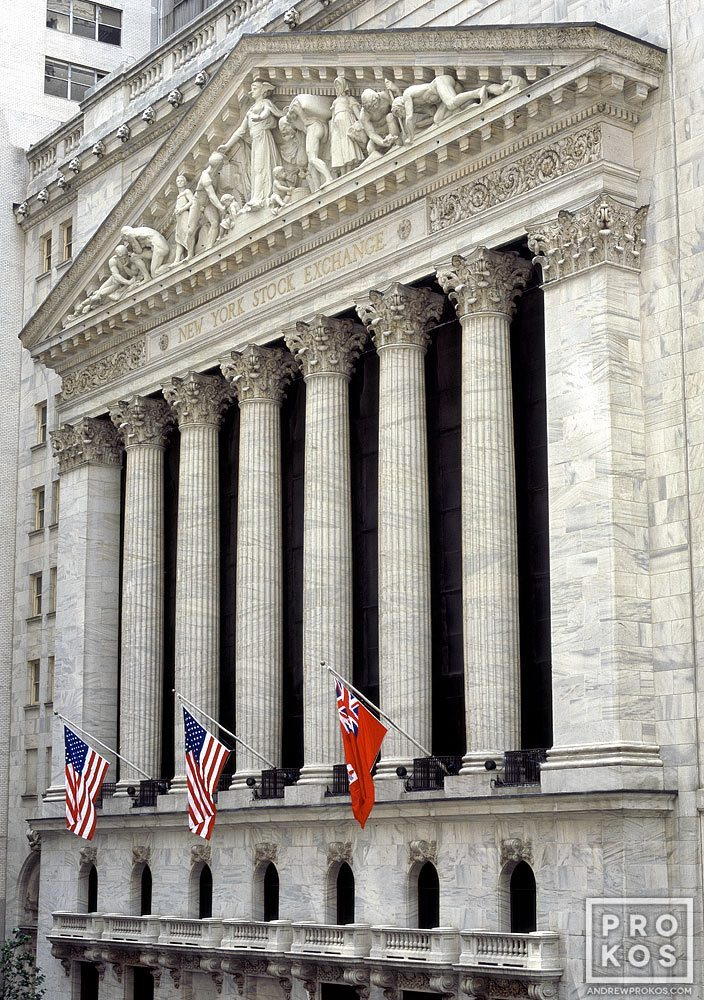 A fine art architectural photo of the facade of the New York Stock Exchange (NYSE) during the day