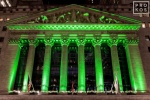 A fine art architectural photo of the illuminated facade of the New York Stock Exchange (NYSE) at night