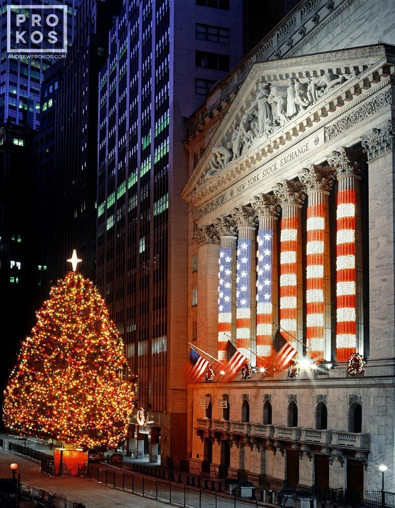 A fine art photo of the New York Stock Exchange (NYSE) with lighted Christmas tree as seen from Wall Street at night