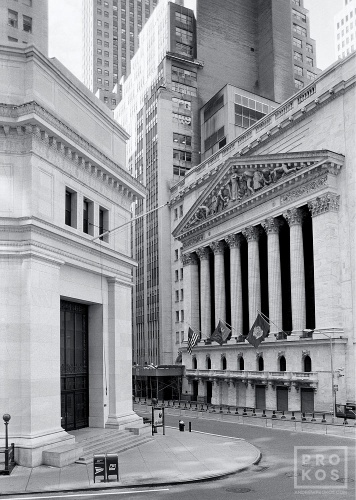 A black and white fine art architectural photo of the New York Stock Exchange (NYSE) as seen from Wall Street