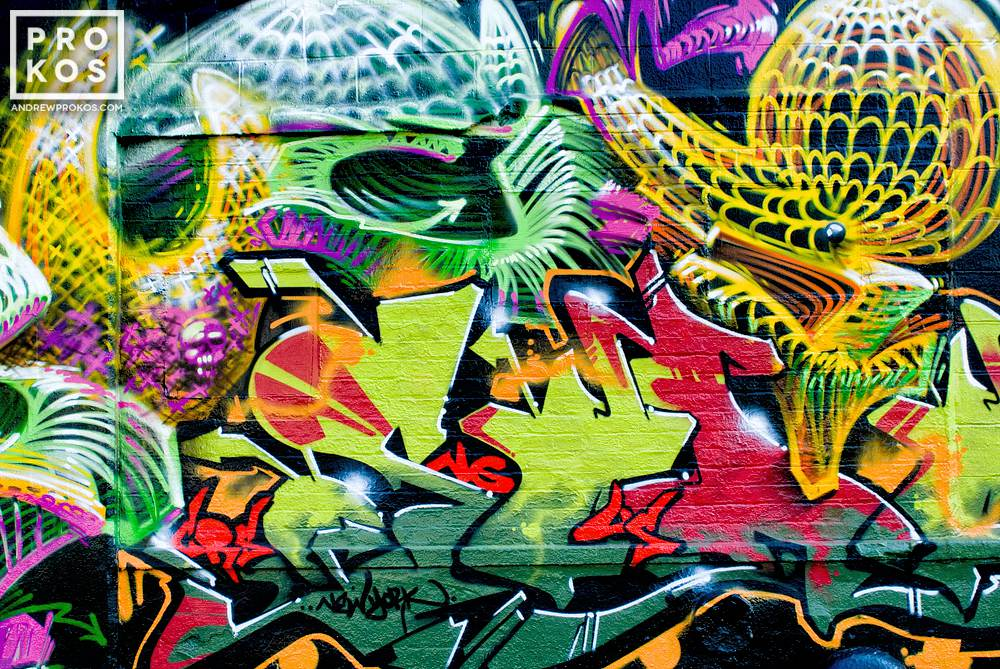 A photo of a colorful abstract street mural in Queens New York