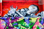 A colorful New York City street mural with skeletons
