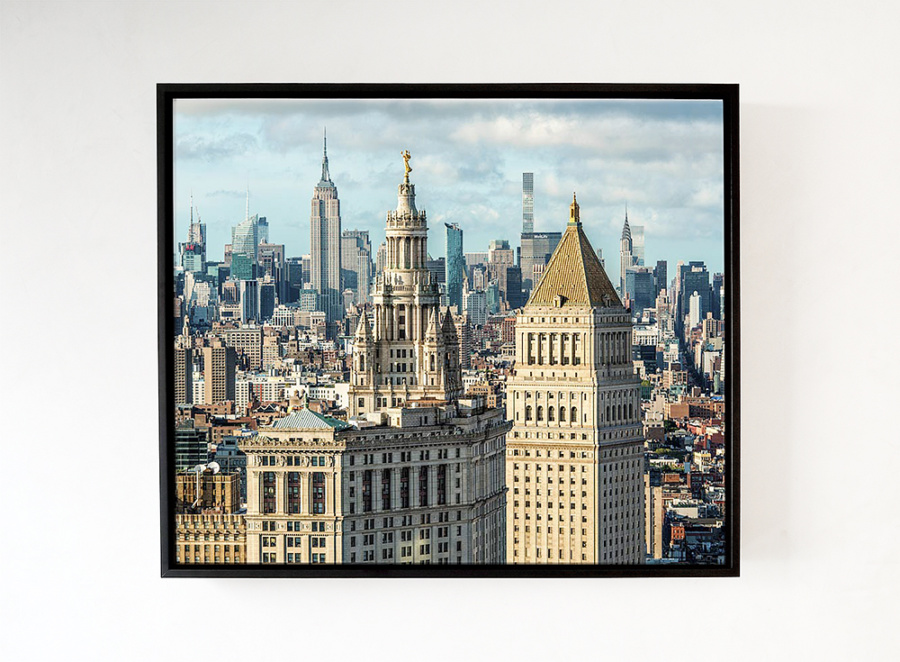 A fine art print of Municipal Building and Midtown Skyscrapers with acrylic float frame in black.