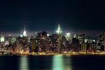 A long-exposure panoramic photo of the New York City skyline as seen from Brooklyn at night