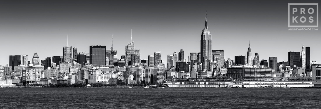A black and white panoramic skyline of New York City and the Hudson River, available as a large-format fine art print framed in various styles.