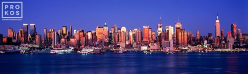 A large format panoramic photo of the New York skyline as seen from Weehawken, New Jersey at dusk