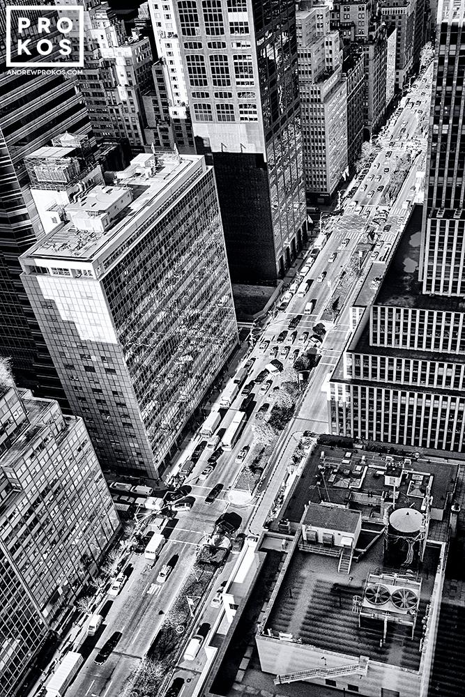 A view of Park Avenue NYC from above, with traffic and surrounding skyscrapers.