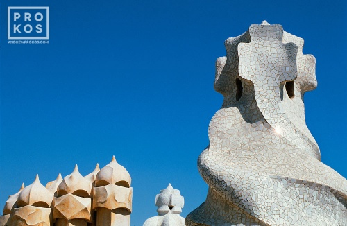 A photo of Antoni Gaudi's famous modernist chimneys on the rooftop of the Casa Mila (La Pedrera), Barcelona, Spain.