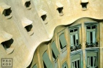 An architectural photo of Casa Mila (the Pedrera), one of the best examples of the Modernist architecture of Antoni Gaudi in Barcelona, Spain