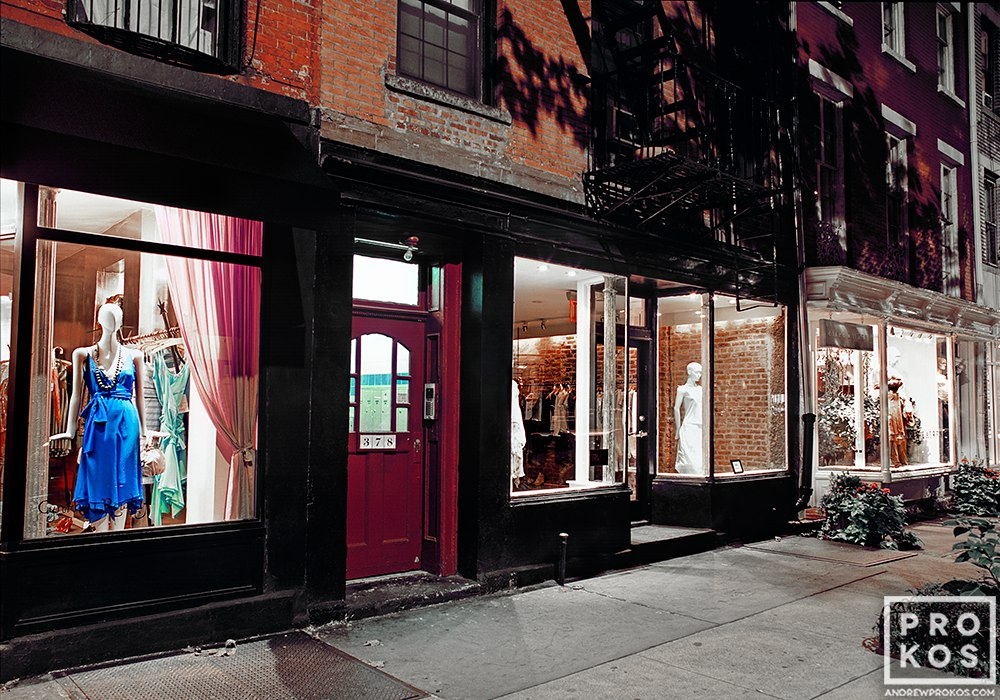 Illuminated store windows on Perry Street at night, West Village, New York City