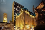 A wide angle photo of the Plaza Hotel at night, New York City