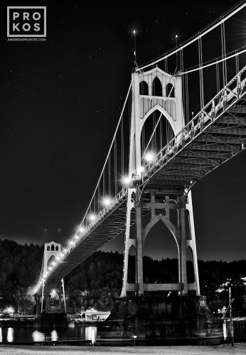 A black and white night photo of St. John's Bridge in Portland, Oregon