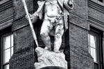 The statue of the Puck on the facade of the Puck Building, NYC in black and white