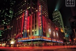 A long-exposure cityscape photo of Radio City Music Hall at night, New York City