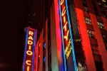 A photo of the neon signs of Radio City Music Hall at night, New York City