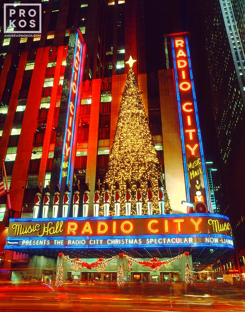 A long-exposure night photo of Radio City Music Hall at Christmas, New York City