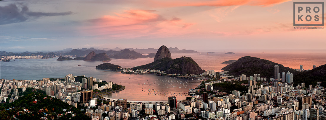 A panoramic photograph of Rio de Janeiro at dusk, including Botafogo and the Sugarloaf Mount.