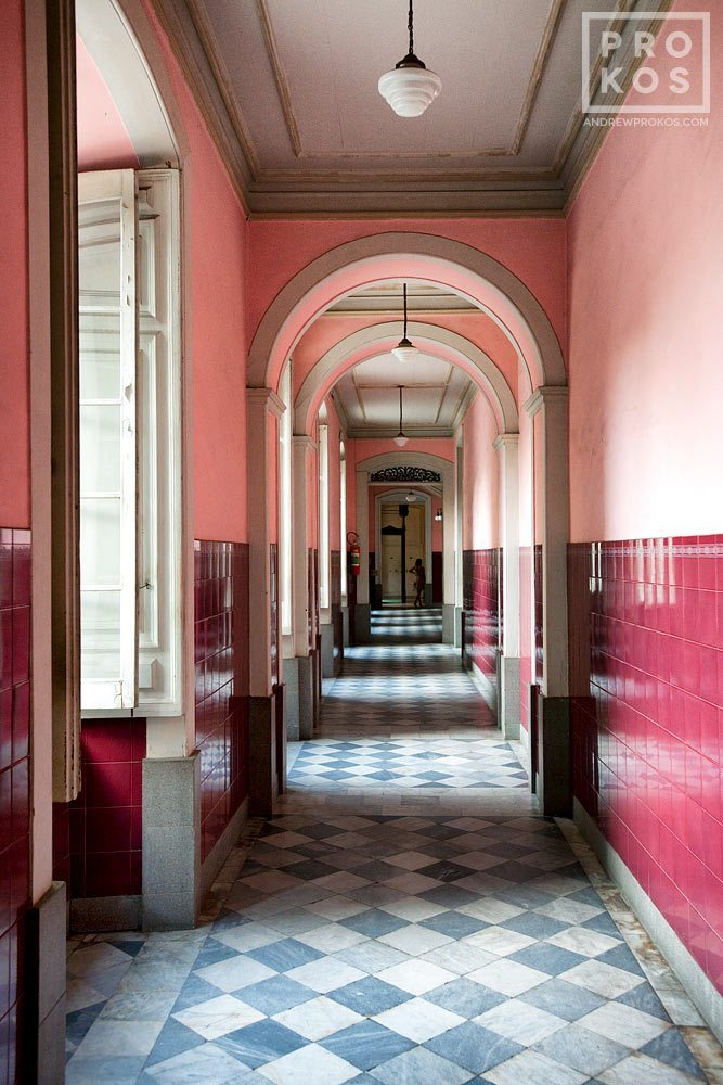 A fine art architectural photo of an interior in shades of pink and maroon, in Rio de Janeiro's Centro Historico.