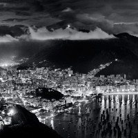 A black and white panoramic view of Rio de Janeiro at night from the Pao de Acucar