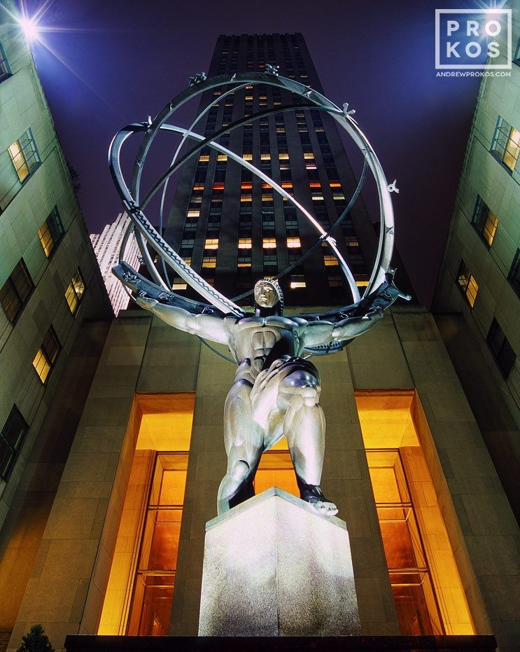 A fine art architectural photo of the famous statue of Atlas at Rockefeller Center at night, New York City