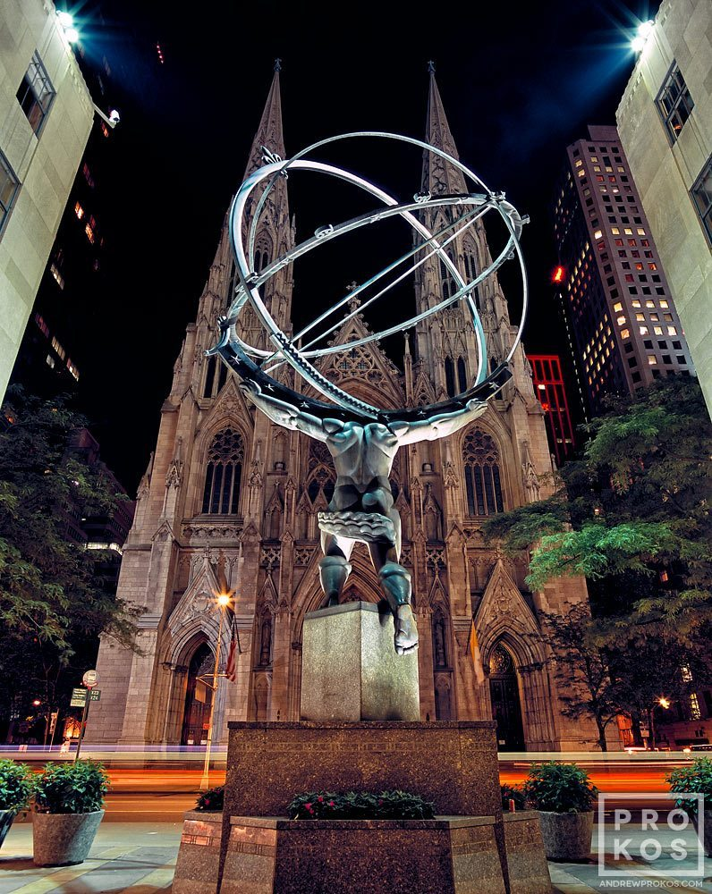 A view of Rockefeller Center's Atlas statue and St. Patrick's Cathedral at night