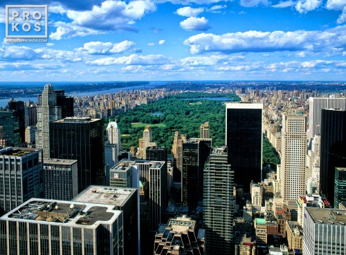 A skyline photo of Manhattan and Central Park from Rockefeller Center during the day