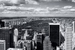 A black and white panoramic photo of Midtown Manhattan skyline and Central Park from Rockefeller Center