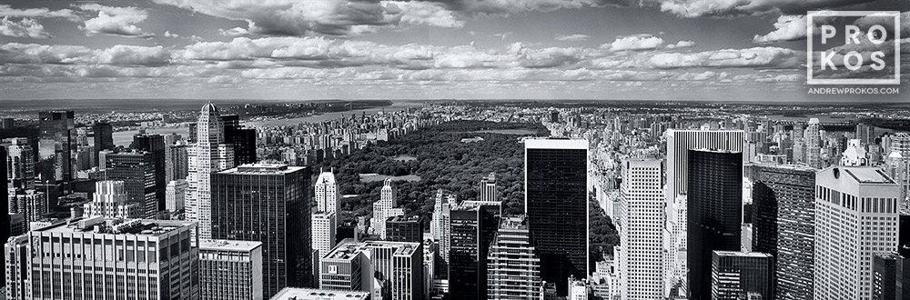 A black and white panoramic photo of Midtown Manhattan skyline and Central Park from Rockefeller Center. Large-format fine art prints of this photo are available up to 120 inches wide.