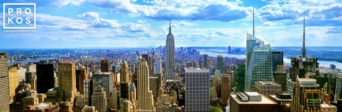 A large-format panoramic view of New York City and the Empire State Building as seen from the top of Rockefeller Center