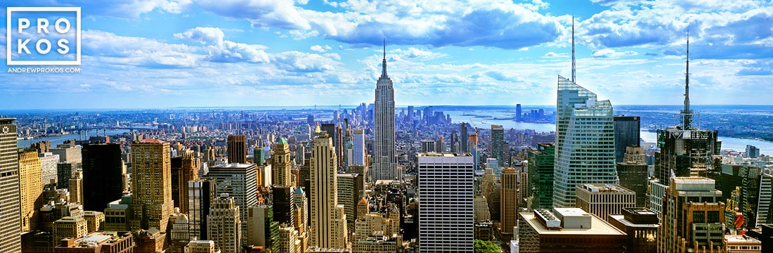 A daytime panorama of New York City and the Empire State Building as seen from the top of Rockefeller Center