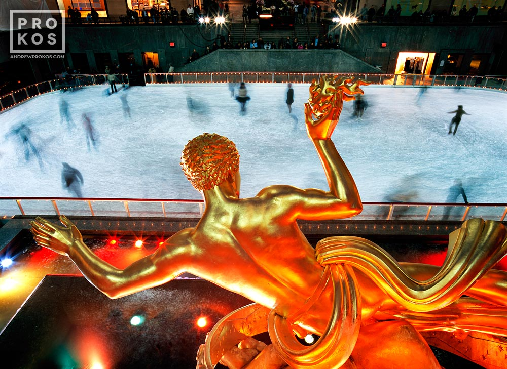 Rockefeller Center's famous Prometheus statue overlooks ice skaters in Winter