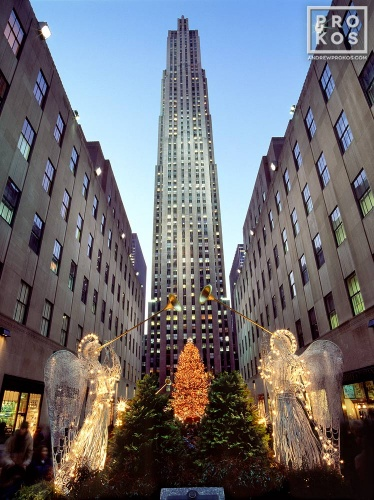 A photo of Rockefeller Center at Christmas with lighted angel decorations, New York City